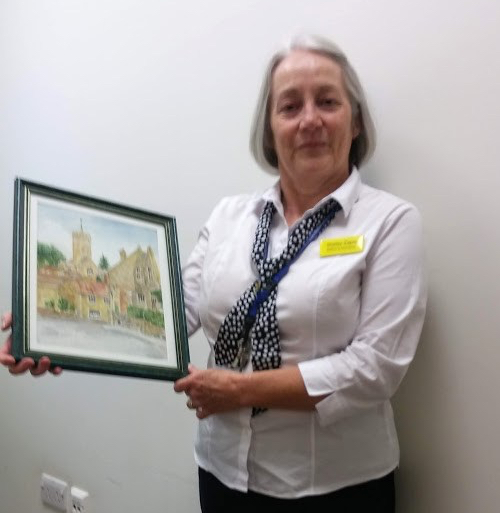 shirley holding a painting of South Petherton